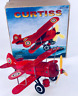 TIN TOY RED BI-PLANE WIND UP PLANE ROLLS & PROP SPINS GREAT COLLECTIBLE