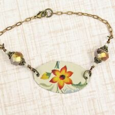 Bracelet made from recycled vintage tin floral bead antique brass red flower
