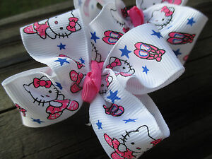 USA Pair of Medium Ballerina Hello Kitty with pink shoe in grosgrain Hair Bows