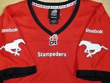 NWOT CALGARY STAMPEDERS CFL Reebok CANADA FOOTBALL Official Red JERSEY Youth M