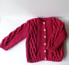 Handmade girl's cardigan with fancy stitch