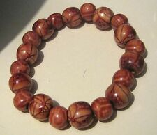 Wonderful wooden beaded bracelet elasticated with beads decorated with patterns