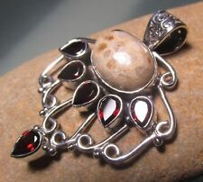 Sterling silver rock floral coral & 6 cut garnet gemstones pendant.