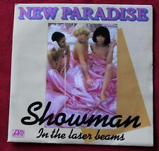 New Paradise, showman / in the laser beams, SP - 45 tours
