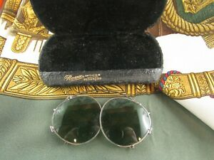 ancienne paire de lunettes main binocle epoque 1900 lorgnons pince nez soleil