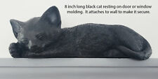 Black figurine door topper with sleeping eyes