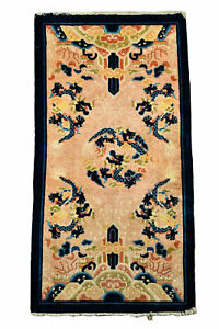 An Antique Collectible Chinese Ninxgia Dragon Rug