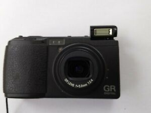 Ricoh GR Digital Camera. Good working order. NO CHARGER. Dust noted on sensor.