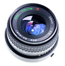 Tokina 28 mm f 2,8 rmc II con Minolta MD puerto sn:8219487