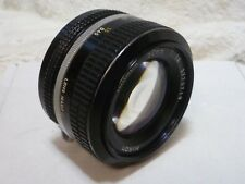 Nikon Nikkor 50mm f/1.4 Ai Lens with front & rear lens Caps view pictures