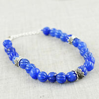 Earth Mined Blue Sapphire 80.00 Cts Round Shape Carved Beads Bracelet - On Sale