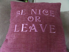 Novelty cushion in Rasberry Chenille with BE NICE OR LEAVE embroidered saying