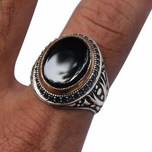 Flat Onyx Cabachon Ring with Bronze Accent & Crossing Double Blade Sword Shank
