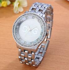 Reloj D Q G lujoso para mujer plateado con cristales en bisel correa tipo armis