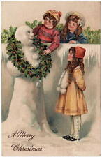 Christmas Postcard Children Putting Holly Wreath on a Snowman~106131