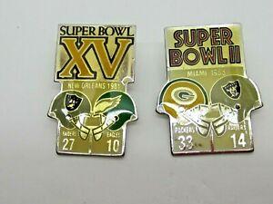 Two Super Bowl Pins Vintage NFL #2 & 15 Starline Raiders vs Packers vs Eagles