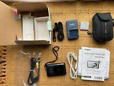 Canon PowerShot Digital ELPH SD1400 IS ,14.1MP Digital Camera - Black, extras