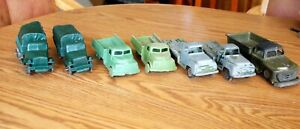 7 Vintage Plastic/Metal toy Trucks and Army Trucks