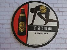Beer Coaster ~*~ 1999 Guinness Stout ~*~ It Gets In You ... Runner About to Run