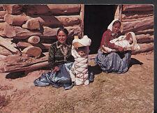 America Postcard - Navajo Women Sit In Front of Their Log & Mud Hogan B2649