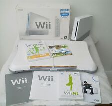 WII CONSOLE BOXED AND WII FIT BALANCE BOARD INCLUDING A FREE YEARS WARRANTY