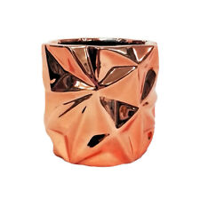 GEOMETRIC ROSE GOLD CERAMIC JAR.