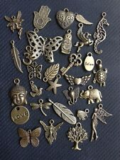Antique bronze mixed charms x 25