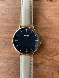 Cluse Women's Watch - black and gold with leather strap