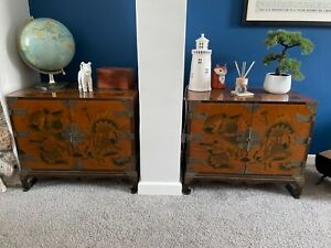 A fabulous pair of vintage Chinese lacquered cabinets decorated with flowers and