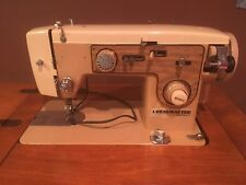 White Dressmaker Model 766 Sewing Machine and Cabinet