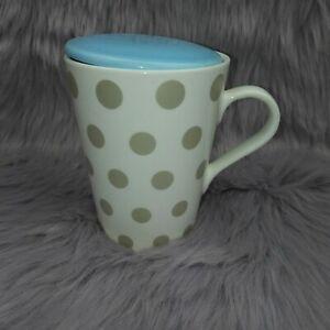 Crate & Barrel grey polka dot ceramic mug with blue lid