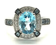 Sterling Silver 925 Oval Swiss Blue Topaz X Accent CZ Halo Cocktail Band Ring 7