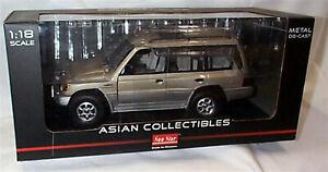 Mitisubishi Montero Long 1998 3.5 V6 Beige Metallic 1-18 scale LHD New in box