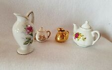 This is a lot of 4 Miniature Ceramic Tea Pots and Pitchers.