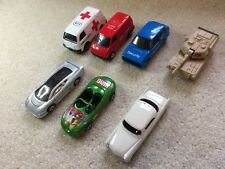 7 Maisto Assorted Die Cast Cars, Vans And Tank 1/64 Scale