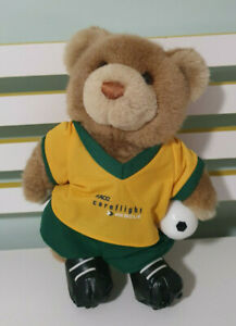 RACQ CAREFLIGHT BEAR SOCCER PLAYER WITH BALL GREEN AND YELLOW SOCCER BOOTS