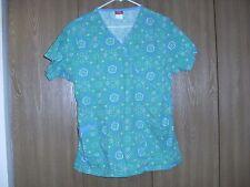 ladies size (M) dickies green floral short sleeve scrub top