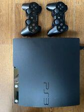 PS3 avec 2 manettes et 9 jeux