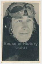 121054, Portraitfoto eines Piloten, Flieger-Schutzanzug, Kopfhaube, Schutzbrille