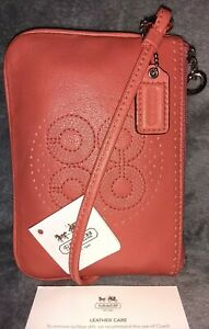 Authentic Coach 45569💥NWT💥Audrey Perforated Wristlet Coral with Silver MSRP$58