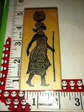 African lady bowl on her head, a stamp in the hand,97,rubber,stamp, wooden