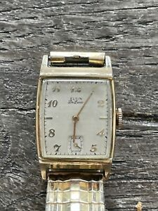 Elgin De Luxe 10k yellow gold Filled watch wind up wristwatch auctions jewelry