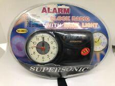 1990s SEALED SUPERSONIC ALARM CLOCK RADIO WITH BACK LIGHT