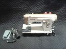 Vintage White sewing machine-gold color