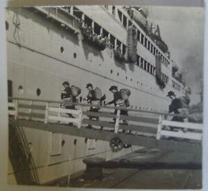 WW2 press photos Royal Navy Wrens with steel helmets board ship