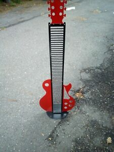 METAL GUITAR DVD OR CD RACK VERY COOL LOOKING WILL HOLD 50 + CD'S