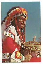 NATIVE AMERICAN INDIAN  Beating a Drum Full Regalia Warfare Vintage Postcard