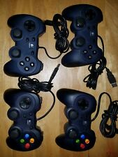 Lot of 4 Used Logitech USB controllers 2 Dual Action and 2 F310