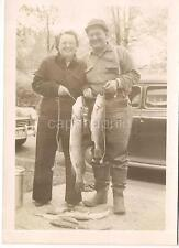 Happy Fishing Couple By Old Cars Holding String Of Big Fish Vintage 1950s Photo