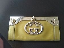 100% authentic Gucci Stralight GG Clutch with Cuff Gold Metallic leather RARE